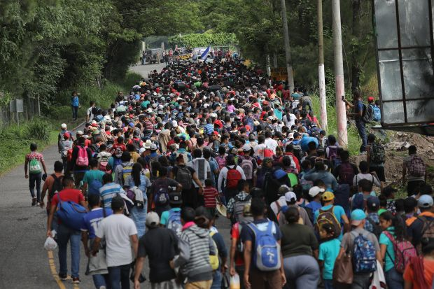 Migrants break through gates at Guatemala Mexico Border